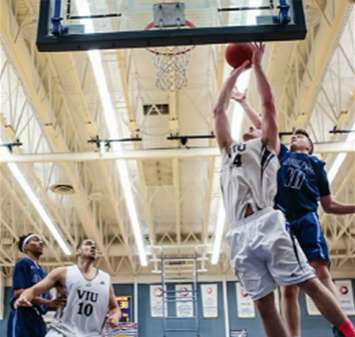 VIU basketball players in action