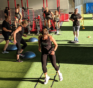 Adults training in gym