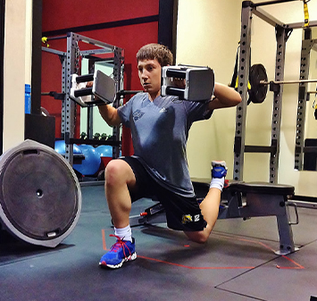 Youth male strength training with weights