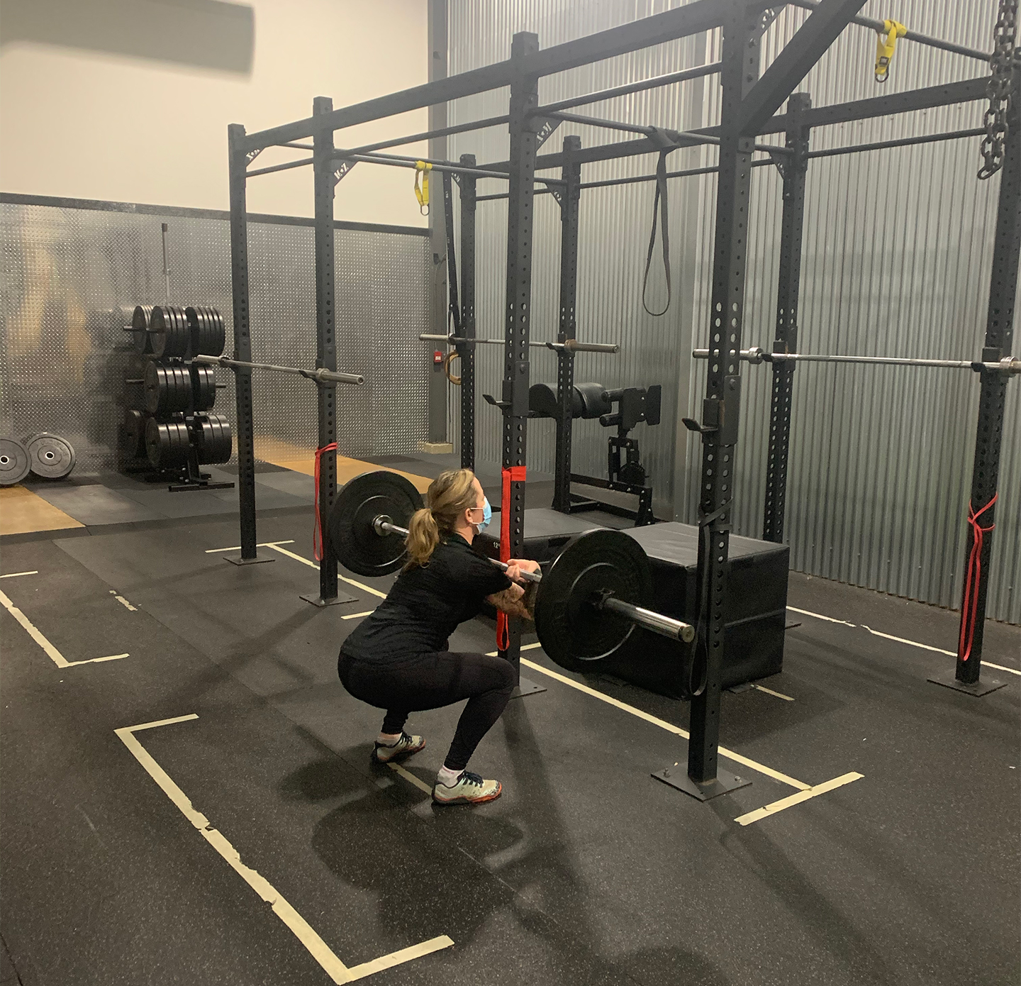 Female weighted squats